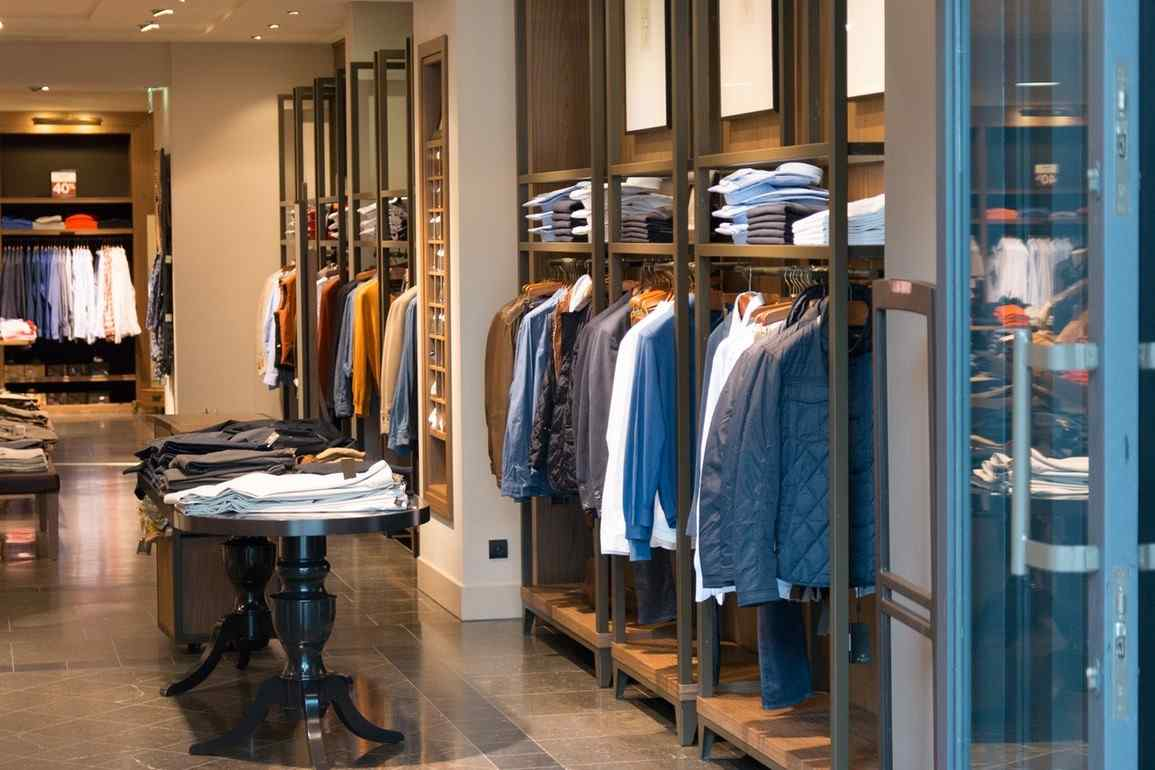 a picture of a retail shop for buying menswear womenswear shoes and accessories
