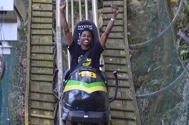 A picture of a man enjoying a bobsled ride at the Outdoor Adventure & Eco-Tourism spot of Rainforest Adventures, Mystic Mountain Jamaica